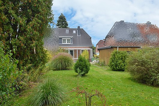 Ihr neues Zuhause - charmante Rotstein-DHH in Wellingdorfer Schwentinenähe
